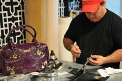 Paco making accessories next to Purple Kenzie Bag