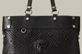 Uh, is that a disembodied head on this Versace bag?