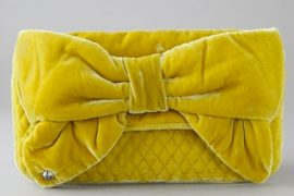 I love this chartreuse velvet Juicy Couture clutch, and you can't stop me