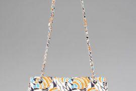 Prada makes a traditional shape into a fun, casual bag