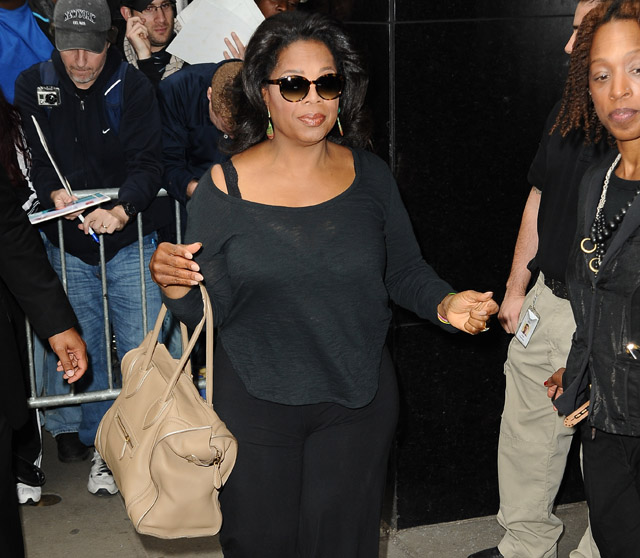 Oprah Winfrey outside of 'Good Morning America' in her bedroom slippers, NYC