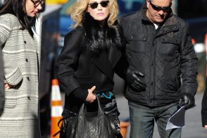 Sharon Stone carries Alexander Wang on the set of her latest movie