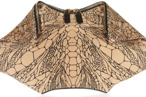 Fill in the Blank: The Alexander McQueen De Manta printed silk-satin clutch is…