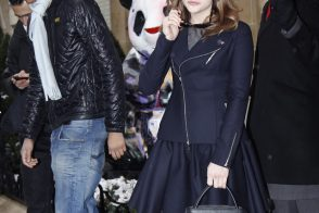 Chloe Moretz attends Dior Haute Couture while carrying a Dior runway bag