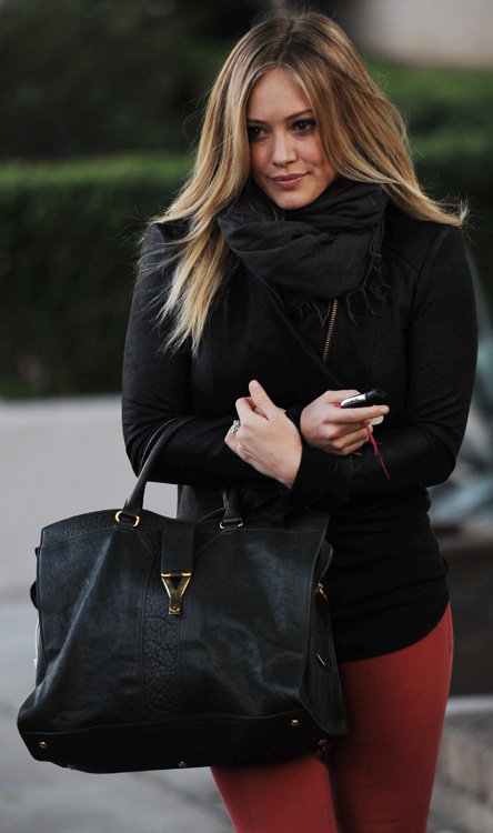 yves saint laurent cluch - The Many Bags of Hilary Duff - PurseBlog