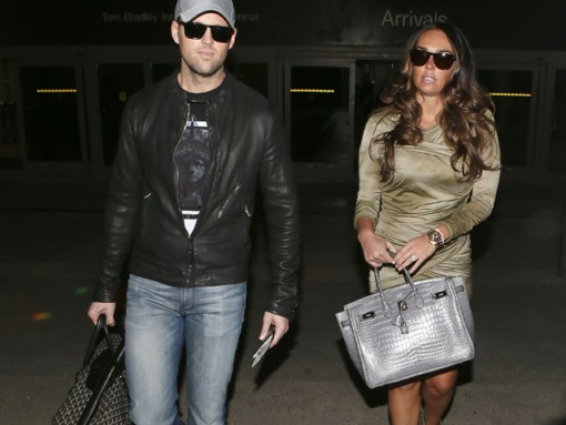 Tamara Ecclestone and her boyfriend Omar Khyami arrived at LAX