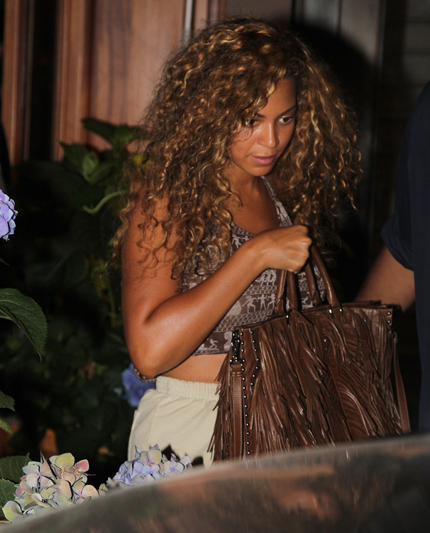 prada clutches on sale - The Many Bags of Beyonce - PurseBlog