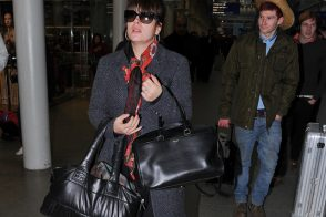 Lily Allen doubles up with Chanel and Saint Laurent bags at the train station