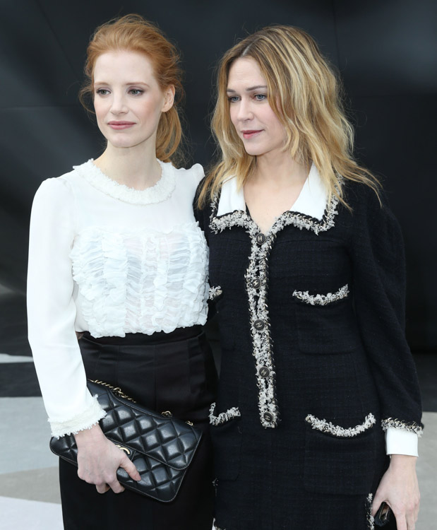 Jessica Chastain carrying a Chanel flap bag at the Chanel Fall 2013 show