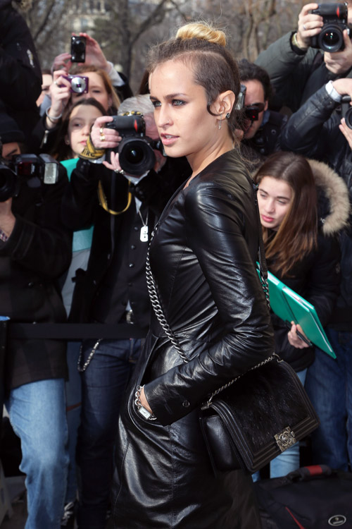 Alice Dellal carrying a Chanel Boy Bag at the Chanel Fall 2013 show