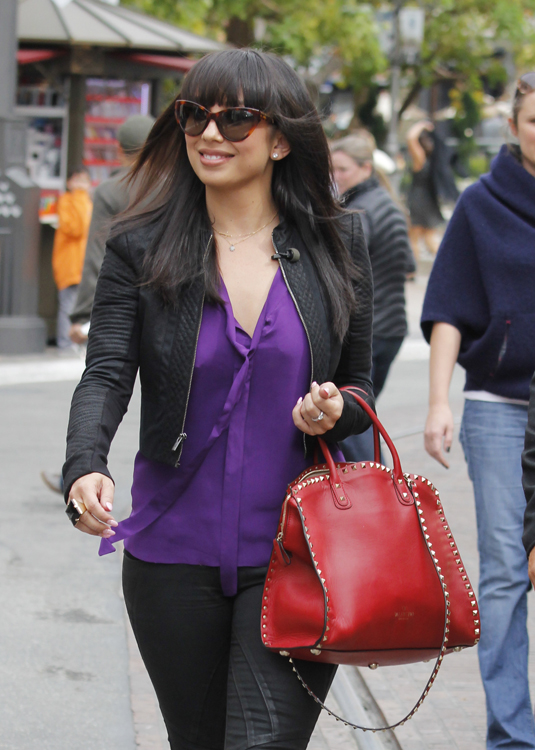 Cheryl Burke carries a red Valentino Rockstud Leather Tote at The Grove in LA (1)