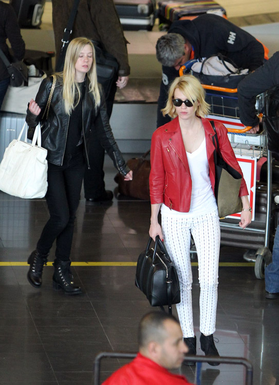 January Jones carries a black Givenchy Lucrezia bag at Roissy Airport in Paris (3)