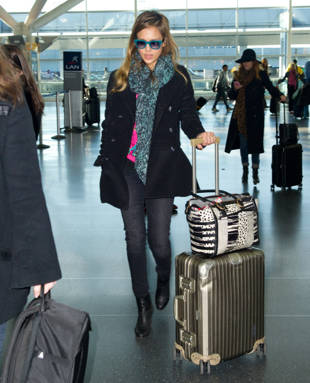 Jessica Alba carries a Christian Louboutin Farida Snakeskin Shopping Tote at JFK Airport in NYC (2)