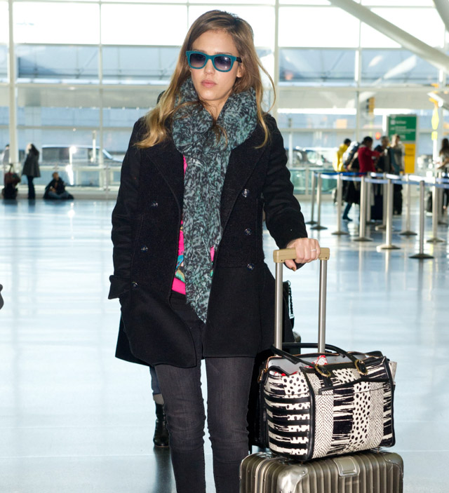 Jessica Alba carries a Christian Louboutin Farida Snakeskin Shopping Tote at JFK Airport in NYC (1)