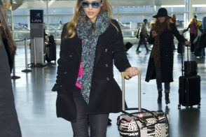 Jessica Alba travels with a Christian Louboutin tote