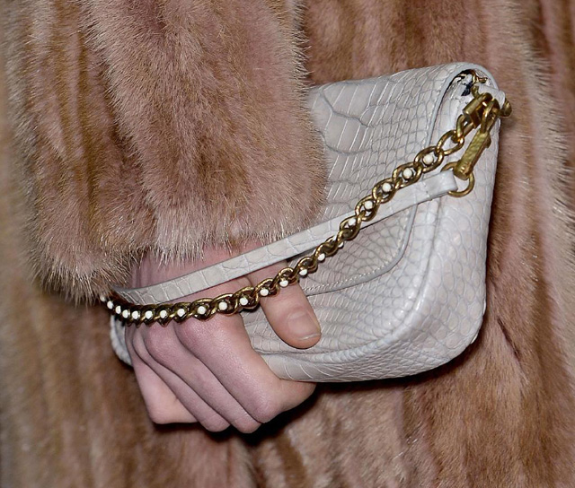 louis vuitton updates the speedy bag in fur and python for