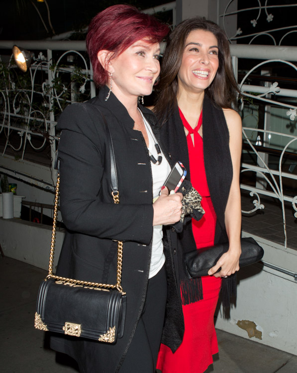 Sharon Osbourne carries a black Chanel Boy Bag with gold accents (3)