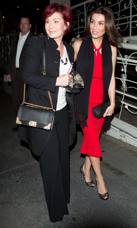 Sharon Osbourne carries a black Chanel Boy Bag with gold accents (2)