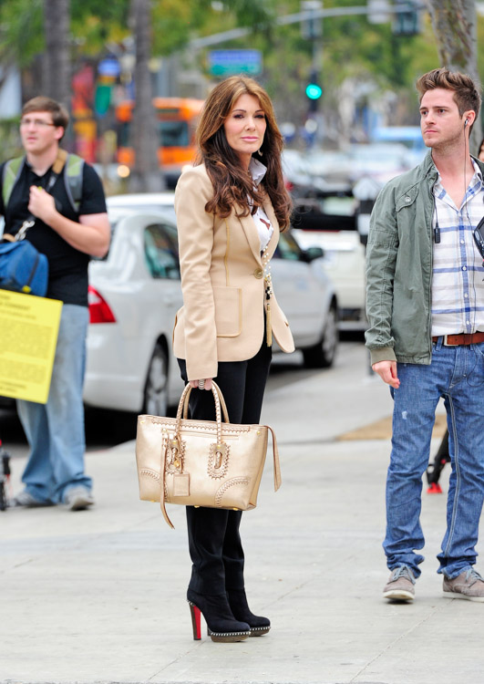 Lis Vanderpump carries a gold Alexander McQueen Whipstitched Tote while scouting a new restaurant location in West Hollywood (1)