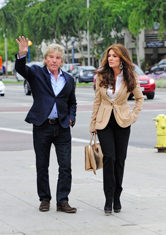 Lis Vanderpump carries a gold Alexander McQueen Whipstitched Tote while scouting a new restaurant location in West Hollywood (4)