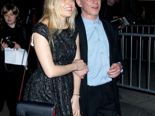 Sienna Miller carries a red and black Delvaux Madame Bag to a Vanity Fair party (5)
