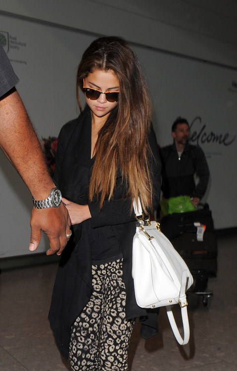 Selena Gomez carries a white Dolce & Gabbana Miss Sicily Bag (1)