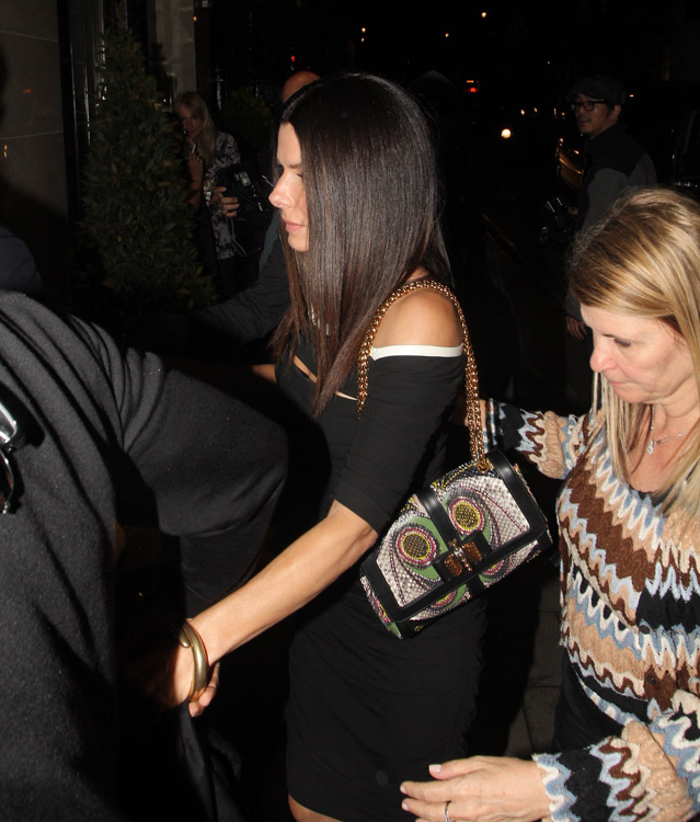 Sandra Bullock carries a Christian Louboutin Sweet Charity Snakeskin Bag in London (3)