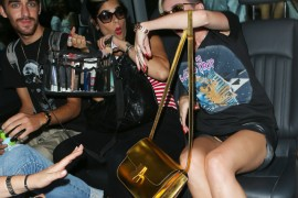 Miley Cyrus carries a gold Celine Classic Box Bag in London (5)