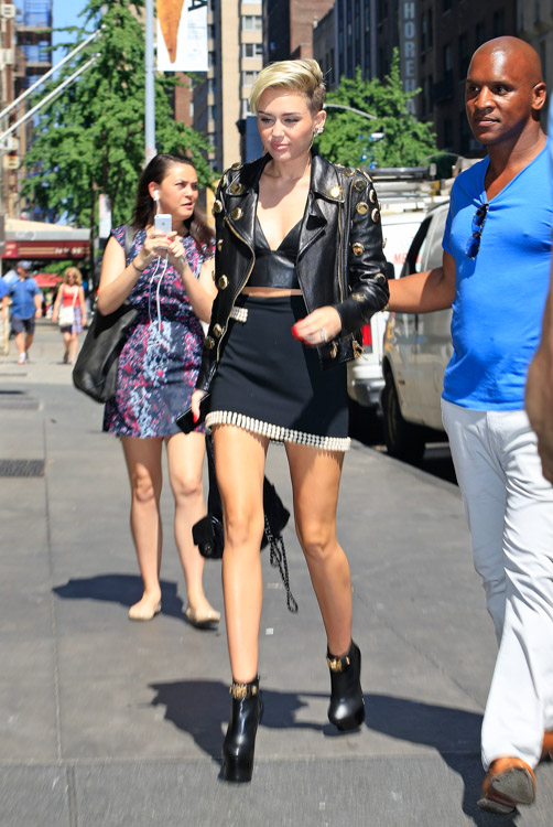 Miley Cyrus carries a black Chanel backpack in NYC (1)