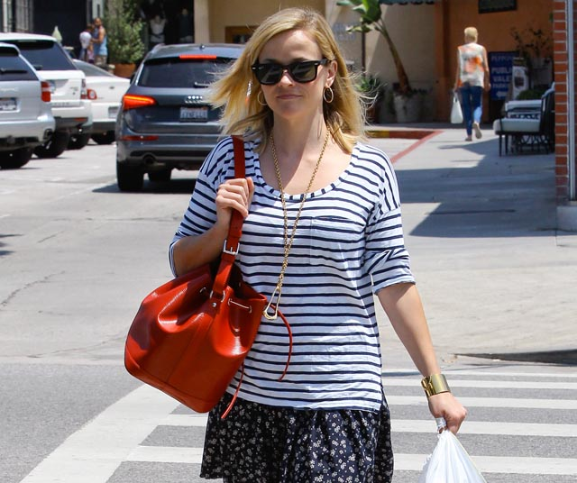 Reese Witherspoon carries a red Louis Vuitton Noe BB Bag in Los Angeles (5)