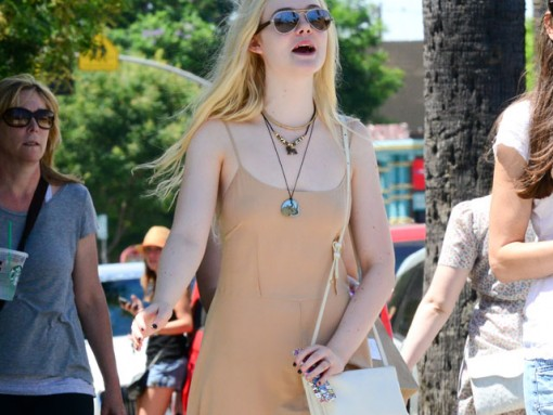 Elle Fanning carries an ivory Celine Trio Bag (5)