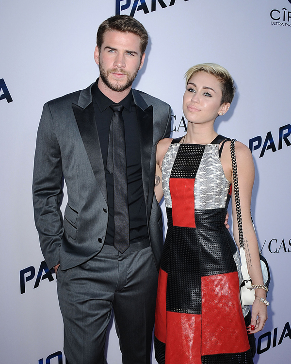 """Miley Cyrus carries a black and white Chanel Boy Bag at the """"Paranoia"""" premiere (2)"""