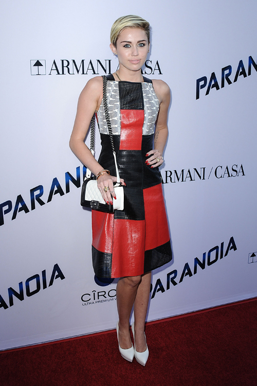 """Miley Cyrus carries a black and white Chanel Boy Bag at the """"Paranoia"""" premiere (4)"""