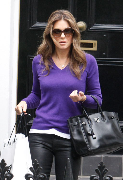 Elizabeth Hurley carries a rare Hermes Birkin in London (2)