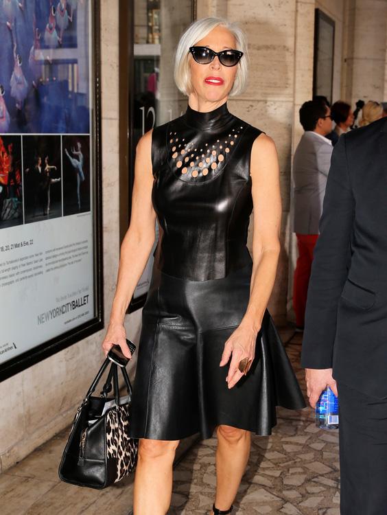 Bergdorf Goodman fashion director Linda Fargo, wearing a black leather dress, leaves the Diane Von Furstenberg fashion show at Lincoln Center in New York City
