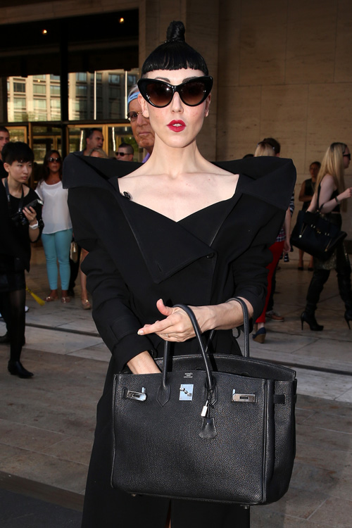 Fashionista Michelle Harper aka Michelle Violy, wearing a black coat and carrying a black Hermes bag, leaves the Diane Von Furstenberg fashion show at Lincoln Center in New York City