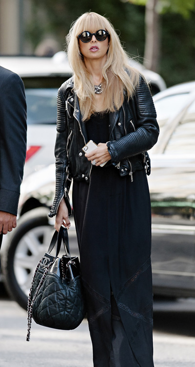 Celebrity fashion stylist Rachel Zoe seen wearing leather motorcycle jacket while attempting to cover her growing baby bump in NYC