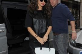 Selena Gomez carries a black and white MICHAEL Michael Kors bag in London (5)
