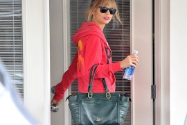 Taylor Swift carries a green Christian Louboutin tote in West Hollywood (5)