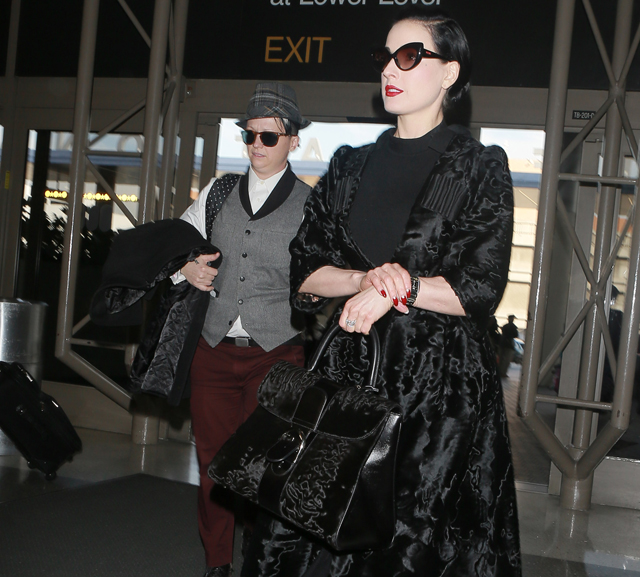 Dita Von Teese carries a black fur Delvaux bag (5)