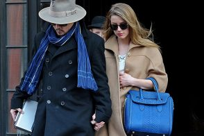 Amber Heard has a McQueen Bag on One Arm and Johnny Depp on the Other