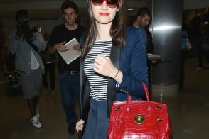Emmy Rossum Travels with a Super Fancy Ralph Lauren Bag