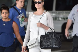 Kate Upton Doubles Up with Dior and Rag & Bone Bags