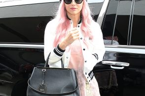 Kesha Looks Polished at the Airport with a Fendi Bag
