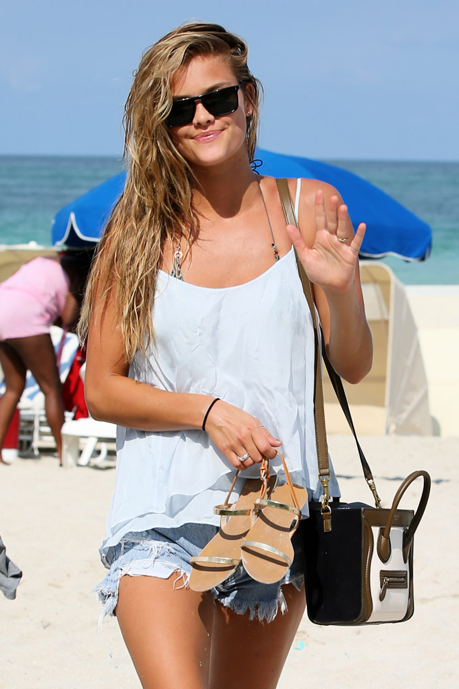Model Nina Agdal Carries a Tiny Celine Tote to the Beach
