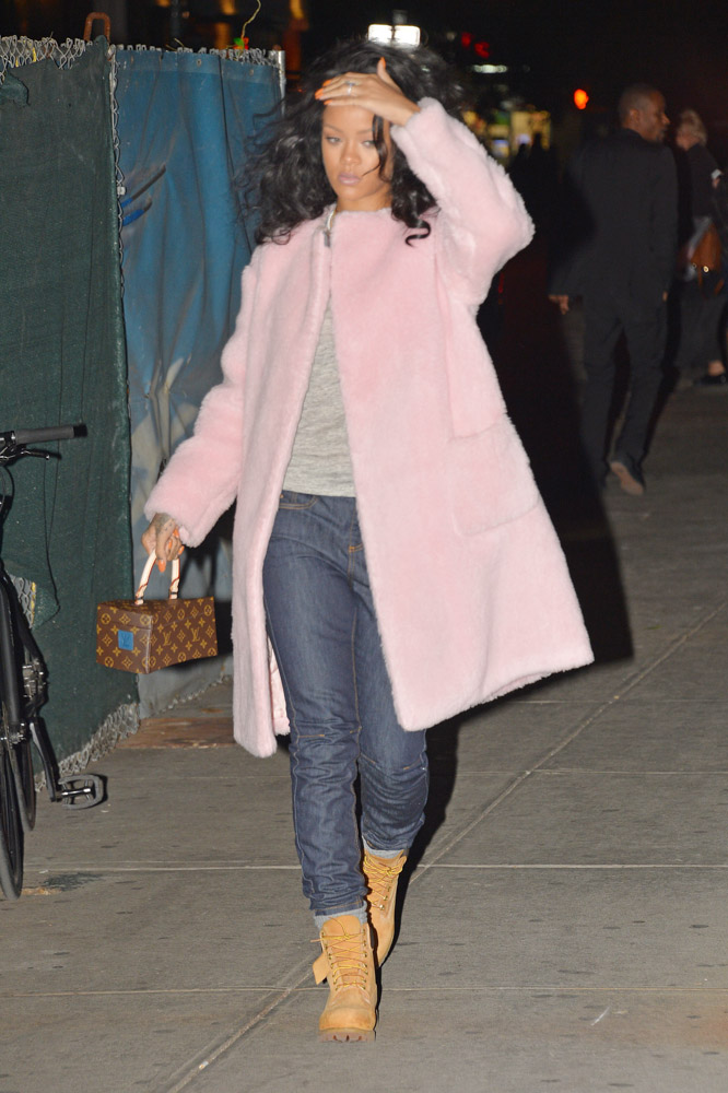 rihanna carries louis vuitton bag designed by franky gehry