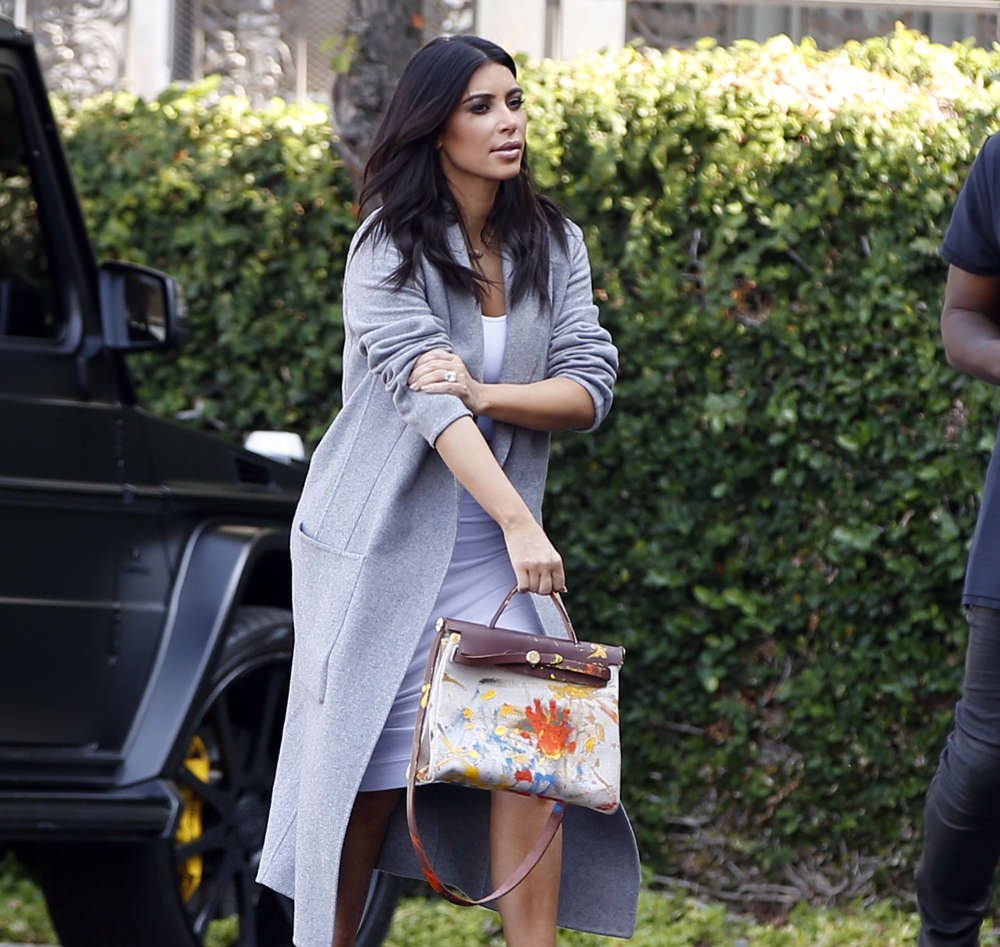 Kim Kardashian and Kanye West head to an office building in Los Angeles, CA