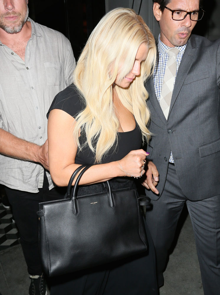 celebrities carry gorgeous new handbags from prada  saint laurent  valentino  u0026 more