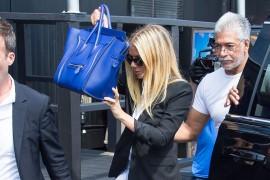 A Visual History of Celebrities Hiding Behind Their Handbags