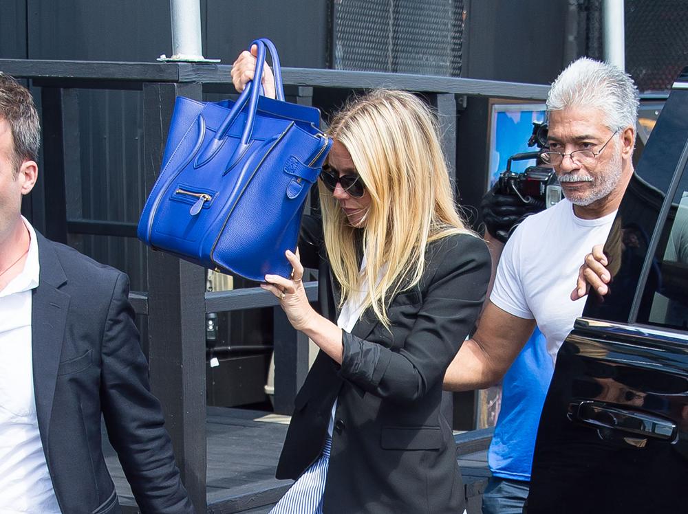 54b967218086f6 A Visual History of Celebrities Hiding Behind Their Handbags
